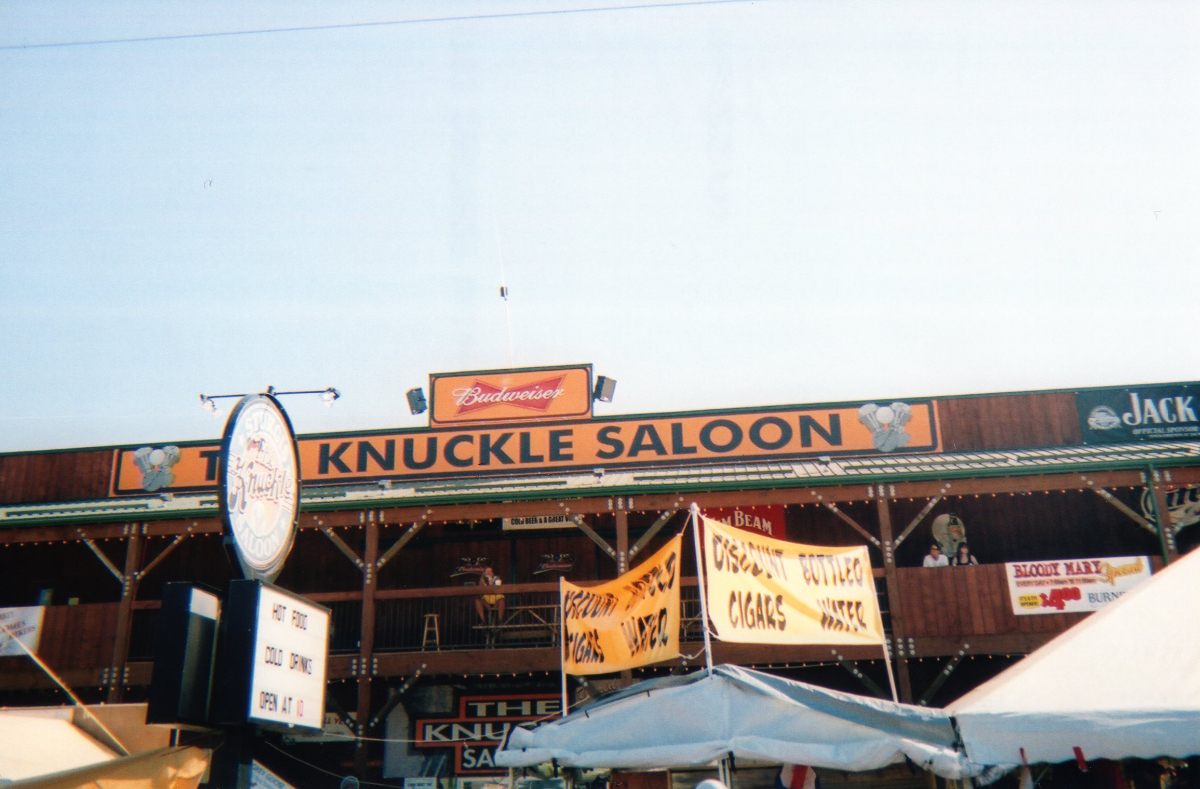 The Knuckle Saloon is home to KNKL-AM, the voice of the downtown during the Sturgis Rally. Two Technomad loudspeakers sit atop the building, unprotected from the elements.,