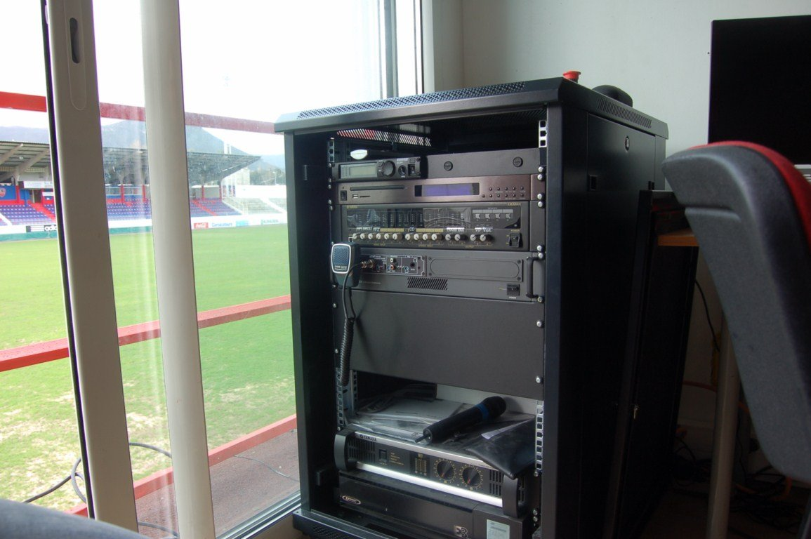 The complete system includes amplifiers and mixers, a wireless microphone, and an automated playout system for security announcements