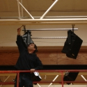 Alex DeMartino at Syracuse Time & Alarm hangs Nohos in the South Lewis middle school gym