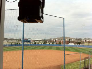 A Technomad Noho Loudspeaker Suspended from Yoke Mount at MTSU Softball Press Box