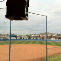 A Technomad Noho Loudspeaker Suspended from Yoke Mount at MTSU Softball Press Box