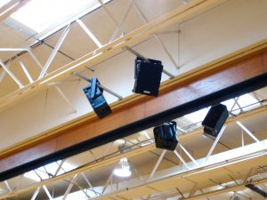 technomad speakers installed on a ceiling beam