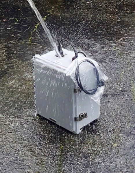 water being poured on a powerchiton amplifier