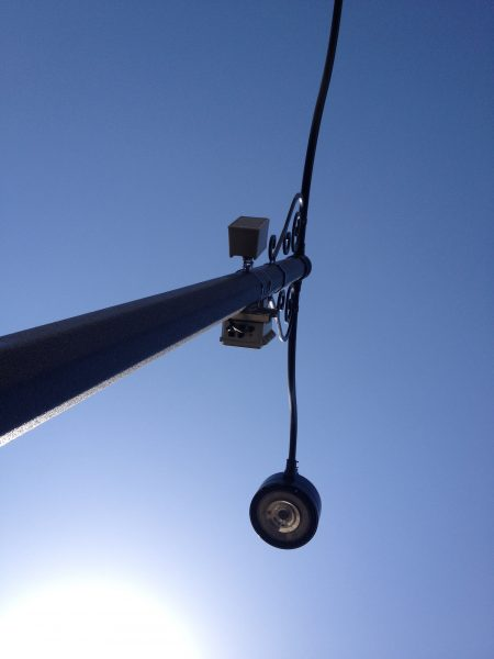 technomad loudspeakers installed on an outdoor light pole
